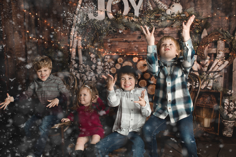 Holiday Portraits | Family Pictures | Christmas Card Photos | Special Needs Photographer | Candid Portraits | Child | Baby | Toddler | Autism | Photography | Fake Snow | Christmas | Cabin Backdrop | Christmas Lights